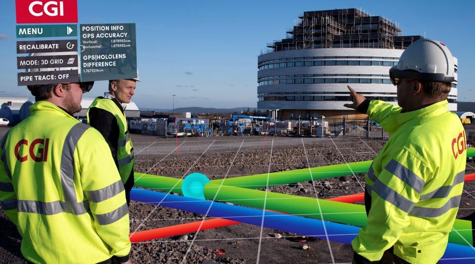 Tre personer ser stadsomvandlingen i Kiruna med CGI:s glasögon med augmented reality